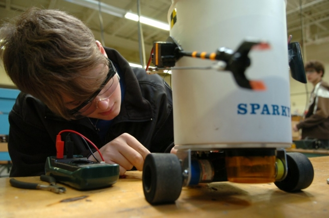 Purvis High School student Tyler Graham, 17, measures the battery voltage of Sparky the robot Tuesday morning during his electronics class at the Lamar County Technical Center in Purvis, Miss. The number of students taking technical training in the county schools has almost double during the past year. (Erin Parker / The Hattiesburg American)