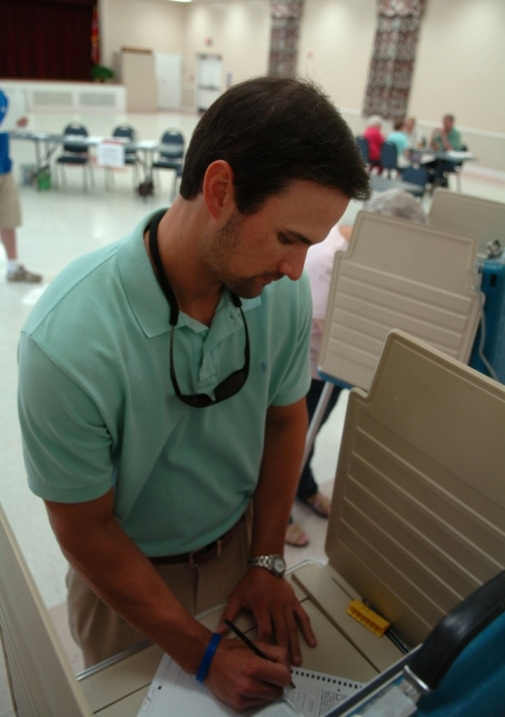 Corey Carpenter fills out his ballot before dropping it into the box Tuesday afternoon at the Petal Civic Center. (Photo by Erin Parker / The Hattiesburg American)