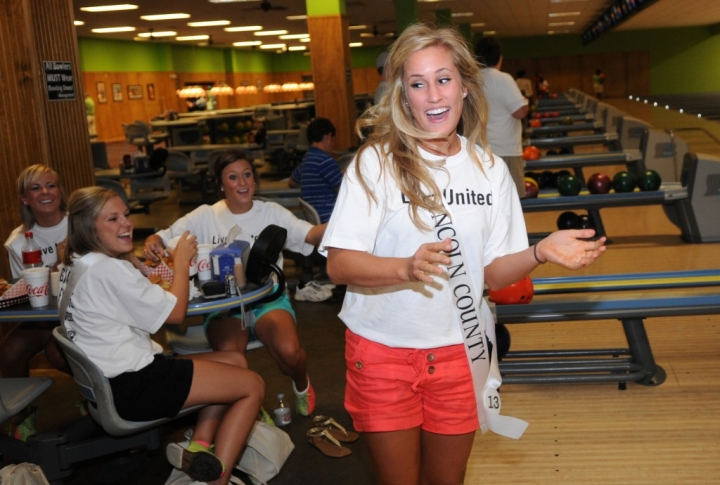 "Mary Catherine McDonnieal, Miss Lincoln County, celebrates after bowling a spare Wednesday night during the Miss Hospitality ""Bowl Night"" at Champion Lanes in Hattiesburg. (Erin Parker / The Hattiesburg American)"