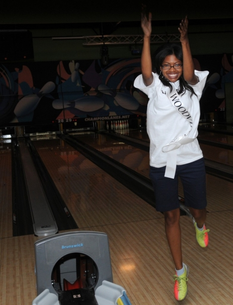 "Cierra Sherman, Miss Woodville, celebrates after bowling a strike Wednesday night during the Miss Hospitality ""Bowl Night"" at Champion Lanes in Hattiesburg. (Erin Parker / The Hattiesburg American)"