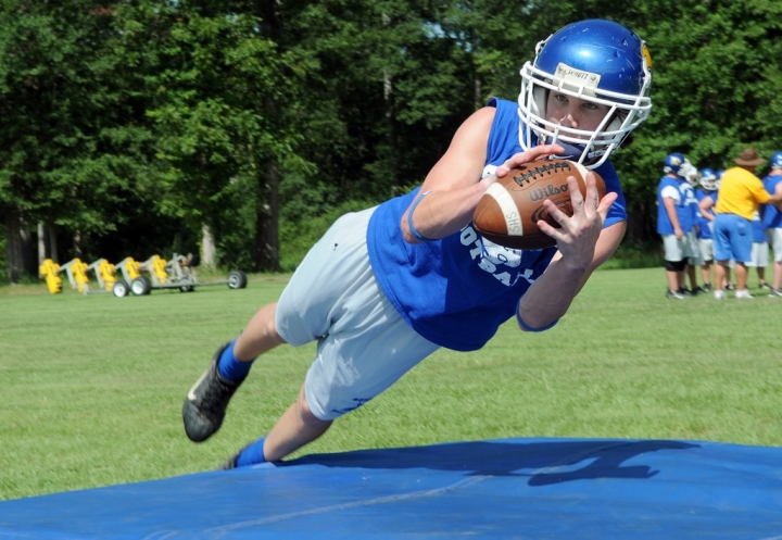 Sumrall High School player Brian Hartfield (12) dives to catch a pass Wednesday afternoon during practice. (Erin Parker / The Hattiesburg American)