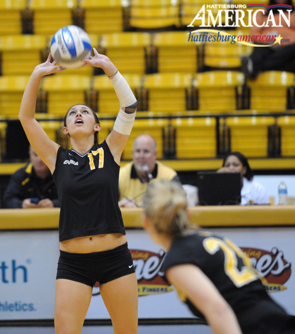 Southern Miss setter Kelsea Seymour (17) sets the ball during the Southern Miss-Rice match Sunday afternoon at the Reed Green Coliseum. (Photo by Erin Parker / The Hattiesburg American)